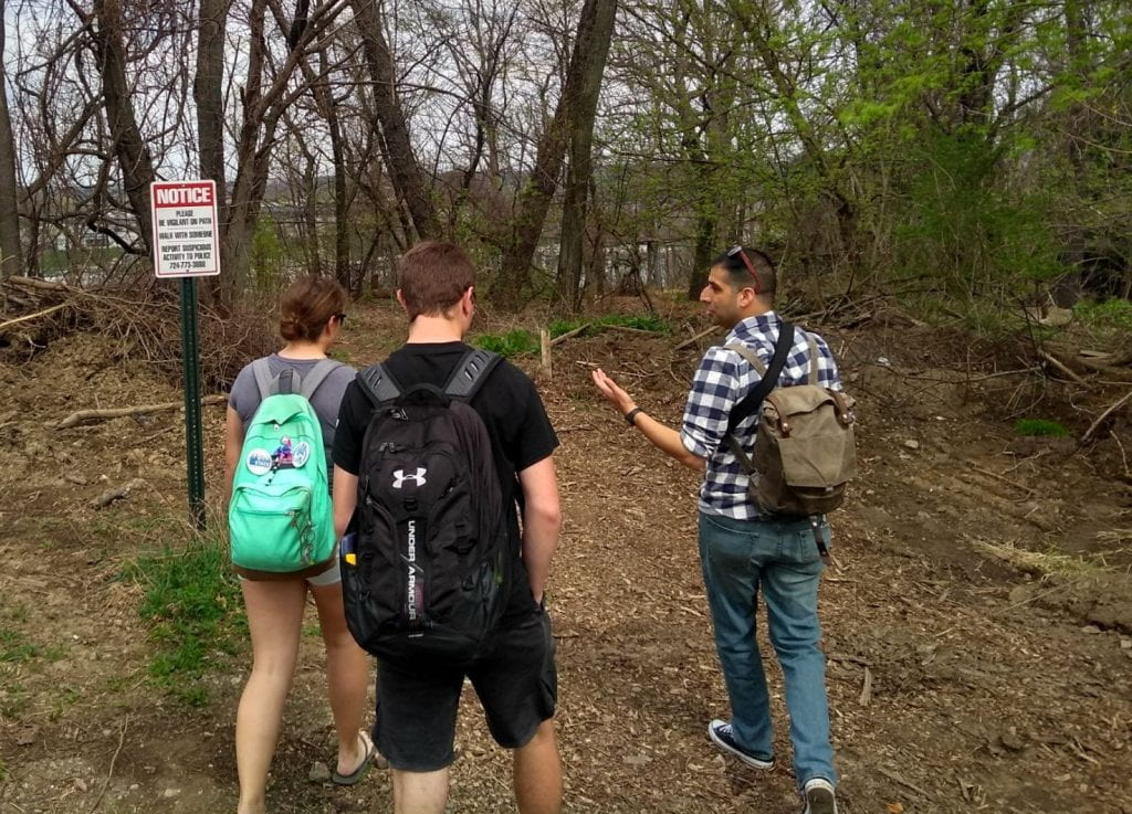 """John gets led to the infamous """"Walmart"""" trail by two of students."""