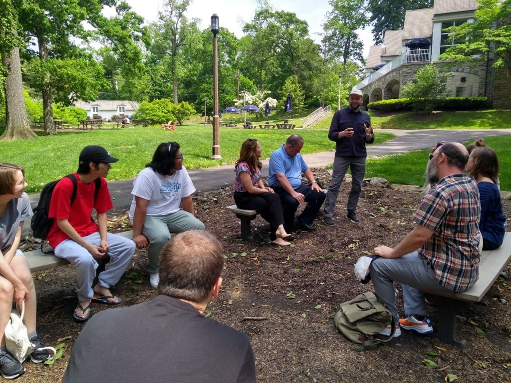 David introduces himself to students, faculty and staff in the campus outdoor classroom space.