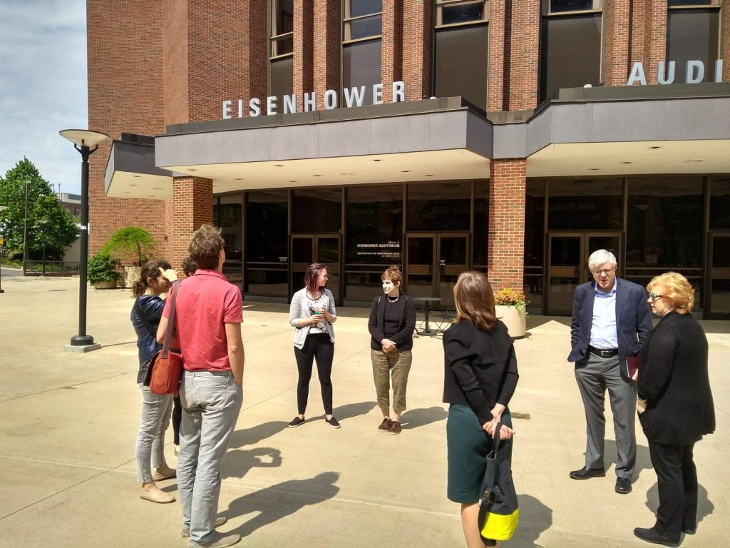 Adam meets with the Center for Performing Arts committee members on the plaza.